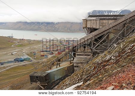 View to the town of Longyearbyen with the abandoned coal mine at the foreground, Norway.