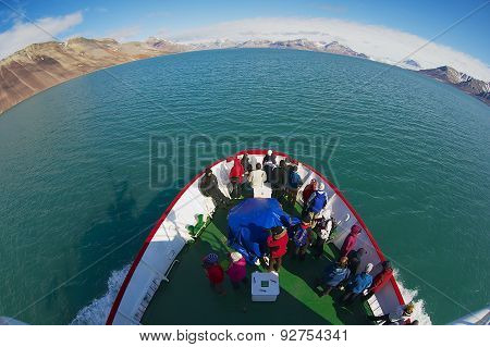 Tourists enjoy the arctic polar sea views from the cruise ship in Longyearbyen, Norway.