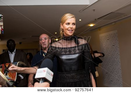 Charlize Theron with fans, 'Mad Max : Fury Road' Photocall during the 68th annual Cannes Film Festival on May 14, 2015 in Cannes, France.