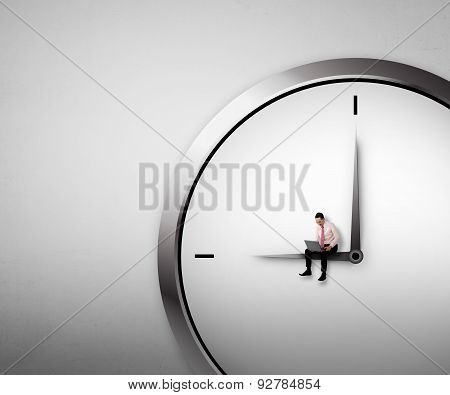 Business Man Sitting On The Clock