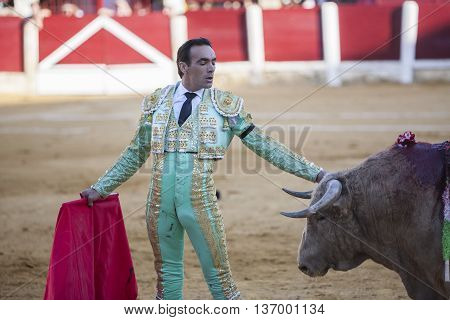 Ubeda Spain - September 29 2010: The Spanish Bullfighter El Cid bullfighting with the crutch in the Bullring of Ubeda Spain