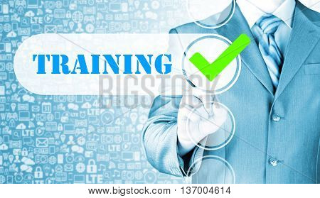 Businessman pressing touch screen interface training checkbox