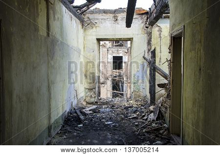 Corridor in abandoned building. Ruins background. Burning building