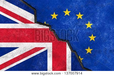 Brexit concept. United Kingdom UK flag on broken wall with European union EU flag.