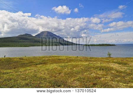 Mountain lake on the Putorana plateau. Water landscape Putorana plateau Siberia Russia.