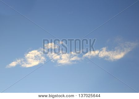 Few little white clouds over blue sky