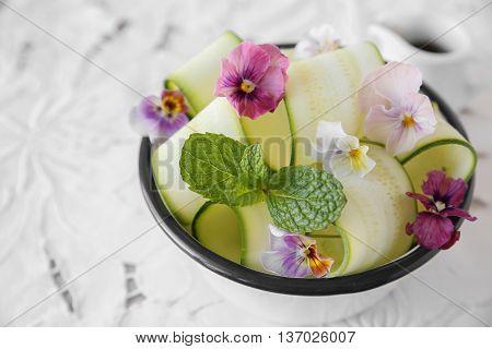 Zucchini salad with edible flowers summer vegan salad