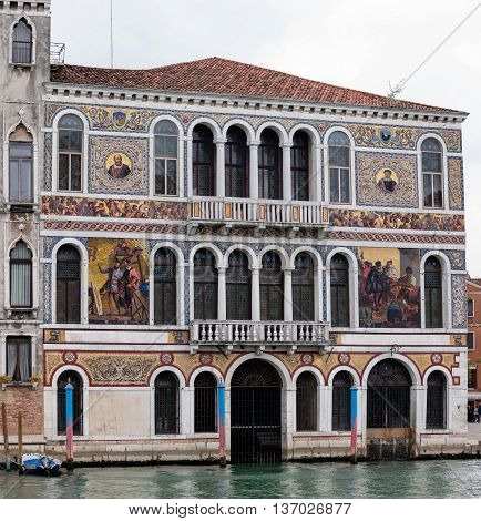 VENICE ITALY - MAY 1 2016: 16th century Palazzo Barbarigo is one of the more opulent palaces on the Grand Canal distinguished by its mosaics of Murano glass applied in 1886.