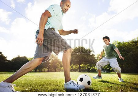 Dad Son Playing Football Together Concept