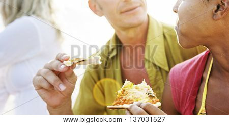 Couple Eating Pizza Beach Party Concept
