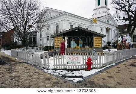 PLAINFIELD, ILLINOIS / UNITED STATES -DECEMBER 29, 2015: A nativity scene, presented by the Plainfield Lions Club, stands outside the Plymouth Congregational Church in downtown Plainfield.