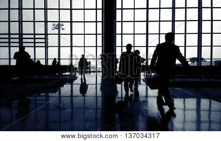 Business Travelers at Airport Concept