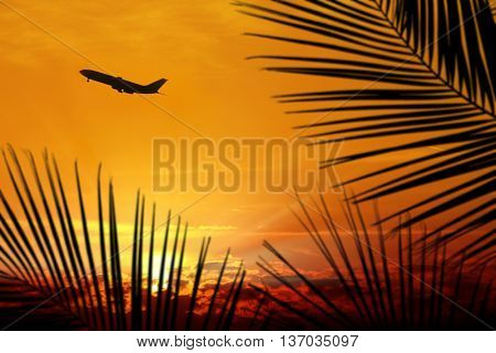 commercial airplane taking off over sunset