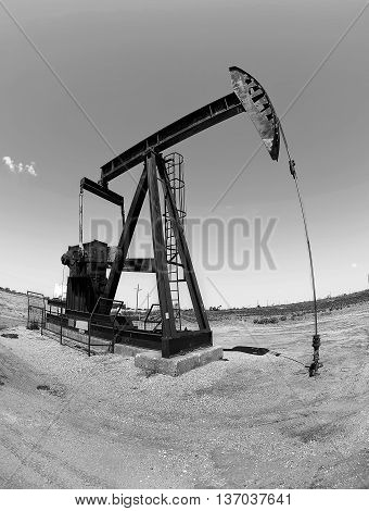 Oil well pumper in black and white with room for your type..