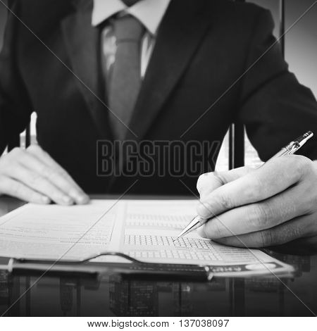 Business man writing on a conference table with an urban scene view.