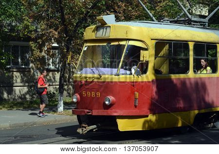 KIEV, UKRAINE - JUL 4, 2016:  Old tram Tatra T3 on the street of Podol district in the historical center of Kiev.July 4, 2016 Kiev, Ukraine