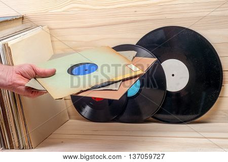 Retro Styled Image Of A Collection Of Old Vinyl Record Lp's With Sleeves On A Wooden Background. Bro