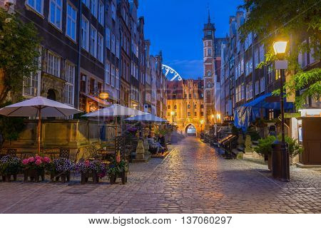 Beautiful architecture of Mariacka (St. Mary) street in Gdansk at night, Poland