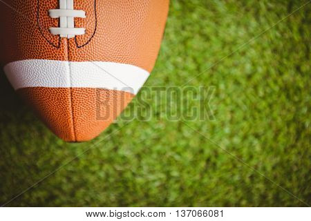 Close up of rugby ball on field