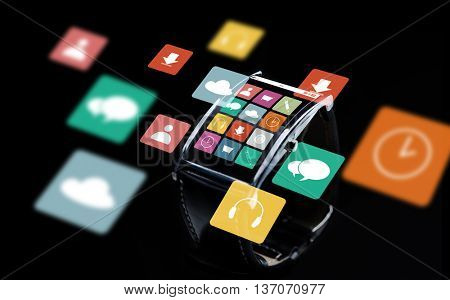 modern technology, object and multimedia concept - close up of black smart watch with menu icons on screen