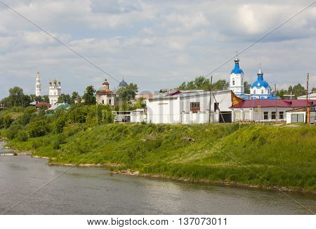 Trinity Cathedral, Church of the Intercession, and Holy Cross Cathedral on the banks of the River Tour. Verkhoturye. Russia.