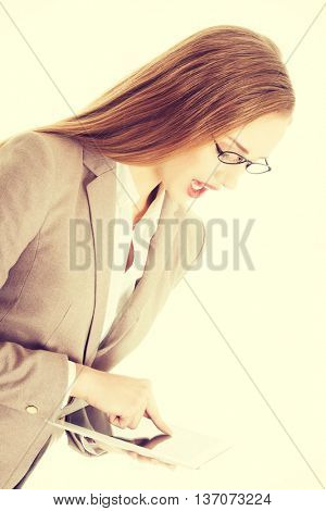 Beautiful caucasian business woman holding tablet.