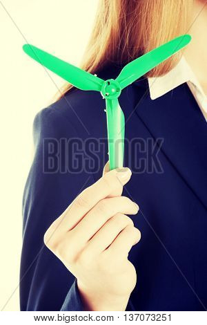 Business woman with green propeller.