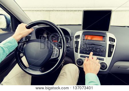 transport, business trip, technology, navigation and people concept -close up of young man with tablet pc computer driving car