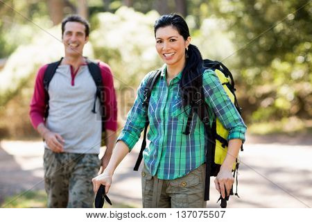 Couple smiling and hiking on the wood