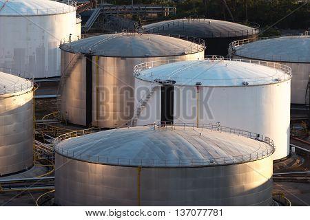 Oil storage tank in petrochemical refinery industry, heavy industrial plant