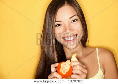 Woman Eating Orange