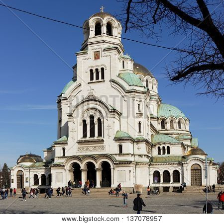 SOFIA, BULGARIA - MARCH 5, 2016: People in front of the St. Alexander Nevsky Cathedral. It was built in 1882-1912, and is the second-largest cathedral located on the Balkan Peninsula