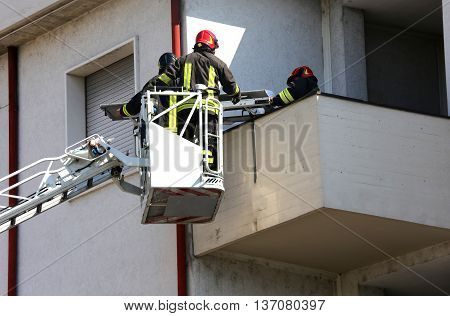 Two Firefighters In The Elevated Cage Of Fire Engine