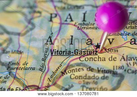 Pushpin marking on Vitoria-Gasteiz Spain. Selective focus on city poster