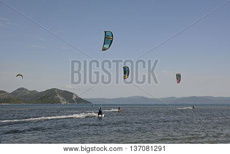 Blace, Croatia - June 18th 2016. Students practice skite surfing at a kite surfing school near the coastak Croatian village of Blace.