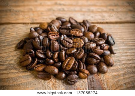 Close up of coffee beans on old vintage wooden table