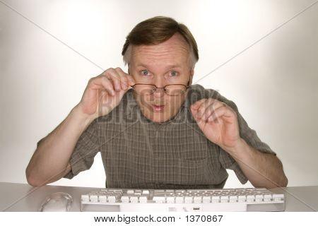 Shocked Man Viewing Computer Screen