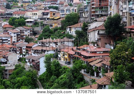VELIKO TARNOVO BULGARIA - JUNE 26 2016: Houses on one of the hills of the town