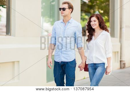 Couple walking in a city hand in hand