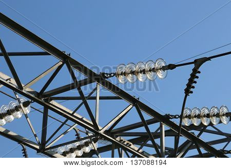 electric cables in aluminum of high voltage to transport the electrical energy and many glass insulators poster