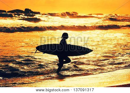 Silhouette Of The Surfer Girl