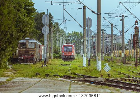 Caracal, Romania - June 19, 2016: Passenger train in station. Train of the National Railway Company (CFR). CFR i is the state railway carrier of Romania.
