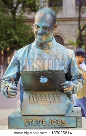Bucharest, Romania - June 10, 2016: Steve Jobs living statue at B-FIT in the Street. B-FIT is a cultural event that involves international artists and acrobats who act in theater plays on street.
