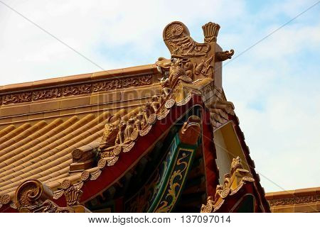 Chinese temple roof apex tile and decoration detail