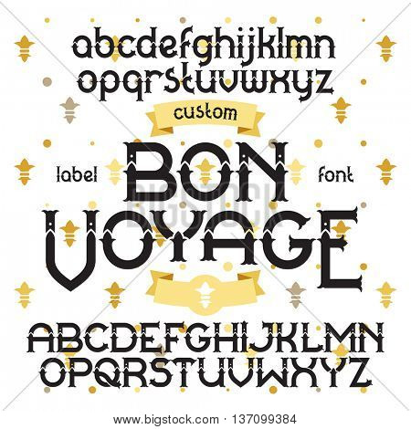 Custom retro typeface Bon Voyage. Vintage alphabet font set on the background of gold royal heraldic lilies