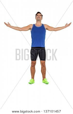 Athlete man standing with arms outstretched on white background