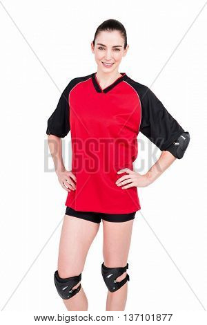 Female athlete posing with elbow pad and knee pad on white background