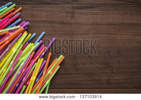 colorful striped bendy cocktail straws on wooden table