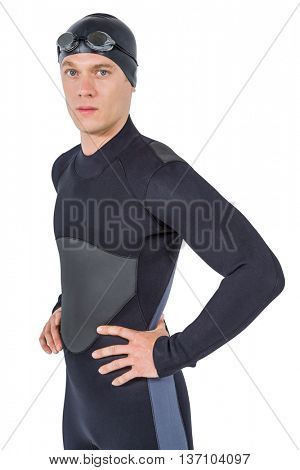 Portrait of swimmer in wetsuit and swimming goggles on white background