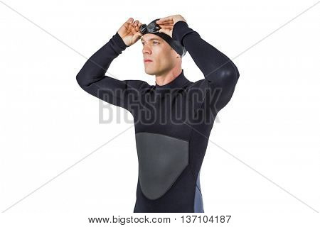 Swimmer in wetsuit wearing swimming goggles on white background